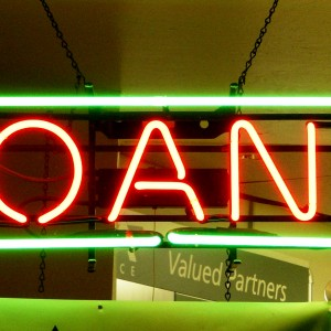 "neon sign saying ""loans"""
