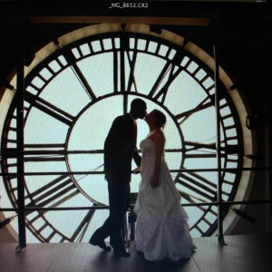 Bridal couple against clock face