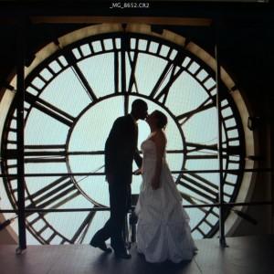Bridal couple against clock face